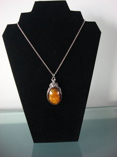 Large Jugendstil silver pendant, set with a natural cognac colour piece of amber and matching antique necklace.