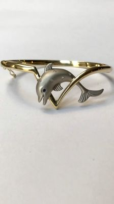 Gold dolphin bracelet with diamond set in white gold