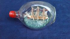 Sailing ship in a dimple bottle