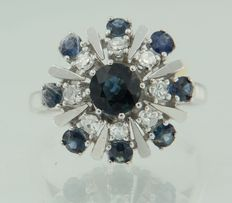 14 kt white gold entourage ring set with sapphire and octagon cut diamonds, ring size 17.5 (55)