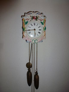 Schwarzwalder wall clock -porcelain front - early last century