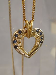 A heart pendant with blue and white sapphires from around 1970