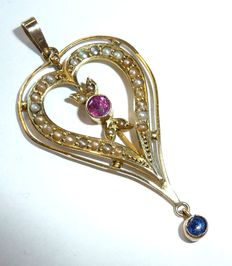 The pendant was made around 1880 to 1900 with many seed pearls and ruby + sapphire in 8 kt / 333 gold - no reserve
