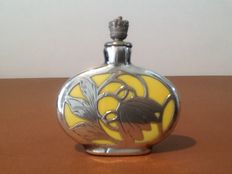 Art Deco perfume bottle with silver overlay