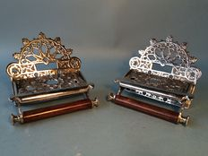 Set of identical silver plated toilet paper holders in Victorian style, 21st century