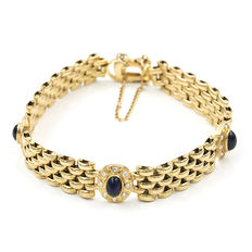 Yellow gold link bracelet with zirconias an cabochon sapphire