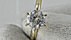 1.25 ct round diamond ring made of 14 kt yellow gold