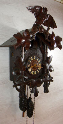 Antique cuckoo clock with special weights - West Germany early 1900s
