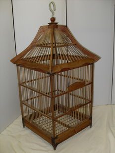Birdcage made of wood with bamboo bars. Very nicely shaped, 2nd half of the 20th century