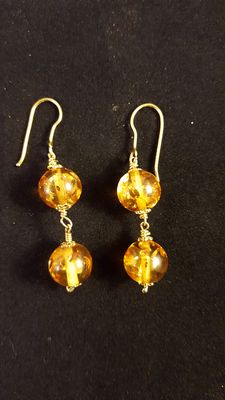 Gold earrings with Russian amber
