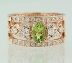 Rose gold ring of 14 kt set with an oval cut peridot and 34 brilliant cut diamonds of approx. 1.55 carat in total, ring size 17 (53)