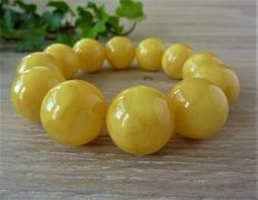 Baltic Amber bracelet in egg yolk colour 52.11 gr