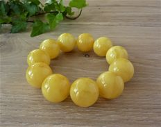 Baltic Amber bracelet, milky yellow colour, 49.18 gr.