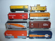 Marklin H0 - 29848 - Eight four-axle wagons with Caboose USA