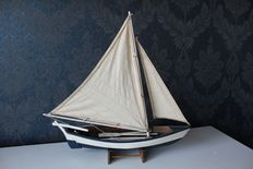 Detailed wooden model of a fishing boat on stand