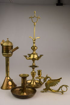 Two old oil lamps and two candlesticks