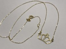 Gold necklace with gold crown-shaped pendant.