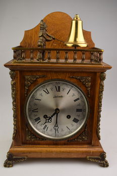 Table clock - man striking the bell with hammer- second half 20th century