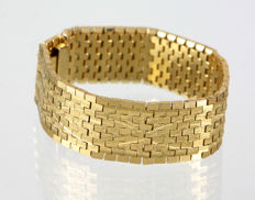 A wide bracelet for women, gold-plated