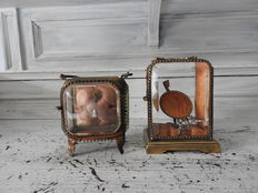 Two old Venetian pocket watch display cabinets.