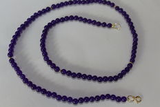 Women's necklace in gold with amethysts of 4 x 4 mm with 5 gold bead spacers