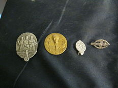 Lot with four different pins from 1935 to 1945