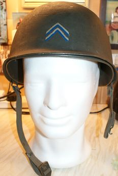 WWII US Army M1 Steel Combat Helmet with removalble lining in Good Condition Numbered Stamped 0588 on overlapping Seam which is all around The Helmet.