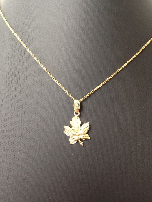 14 kt gold maple leaf pendant on 12 kt gold plated necklace new 14 kt gold maple leaf pendant on 12 kt gold plated necklace new condition aloadofball Gallery