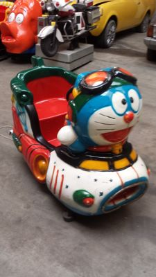Space cat in spaceship kiddy ride