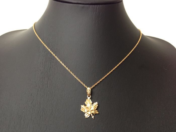 14 kt gold maple leaf pendant on 12 kt gold plated necklace new 14 kt gold maple leaf pendant on 12 kt gold plated necklace new condition aloadofball Choice Image