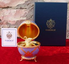 """Faberge Egg Imperial Collection """"The Swan Egg""""- Limoges (France) porcelain, crystals, gold-plated finish."""