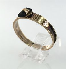 Gold channel ring with black onyx