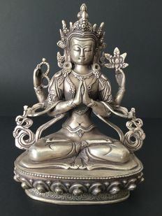 Representation of the Avalokiteshvara Deity in silver-plated copper - Nepal - early 21th century