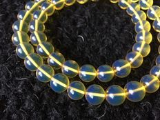Bluish fluorescent Mexican Amber Necklace, 64g