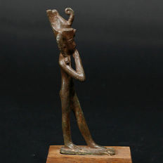 Old Egyptian striding god Harpocrates in bronze - 10 cm
