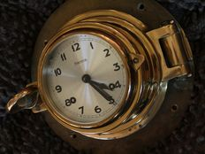 Antique HERMLE glass striking ship clock mounted on heavy brass porthole