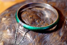 A green enamel bracelet made of Sterling silver