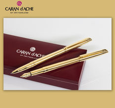 "Caran  D'ache Madison II ""Clou de Paris"" guillochè Gold-plated Rollerball and Fountain Pen Set"