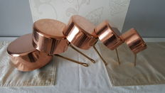 Five pans in solid tinned copper, stamped French manufacturing, Made in France, red copper and yellow copper for the handle.
