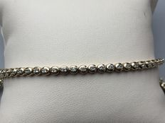 Gold tennis bracelet with 57 diamonds (1.14 ct) with certificate
