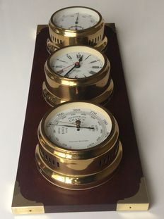 Weather station-ship's clock-barometer - thermometer.