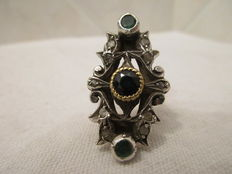 Gold and silver ring with sapphire, emeralds, and antique rose cut diamonds. Circa 1900-1920.