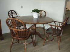 Titmarsh & Goodwin oak table with five windsor chairs, England, late 20th century
