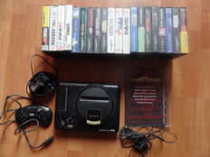 Sega Mega Drive console + cables, with 1 joystick and 20 boxed games