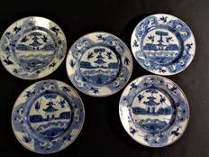 Five porcelain plates depicting a temple surrounded by a garden and flying cranes – China – 18th century