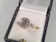 Old 18 kt yellow and white gold ring with diamond of 0.38 ct