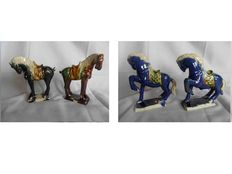 Four ceramic horses - China - two are marked with Chinese characters