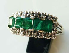 White gold ring with emerald and diamond.