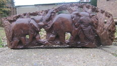carving from tree with elephants - wood