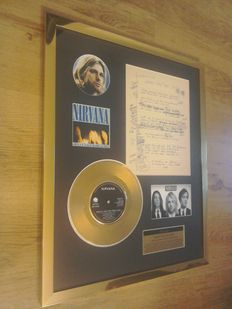 "Nirvana "" Smells Like Teen Spirit ""24Kt Gold Record And Facsimile Of Handwritten Lyrics Display ."